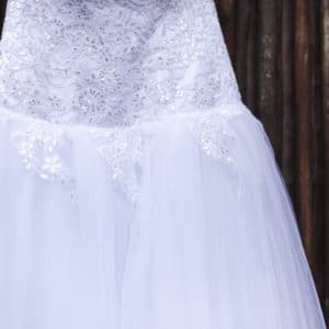 Stunning dropped waist A-line dress with sequined bodice and lace detailing.
