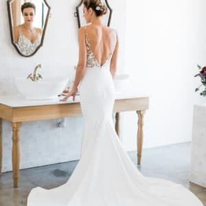 Beautifully fitted milk-white, illusion, hand embroided wedding gown